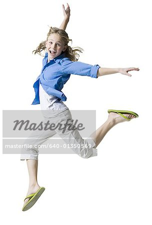 Portrait of a girl jumping Stock Photo - Premium Royalty-Free, Image code: 640-01350569