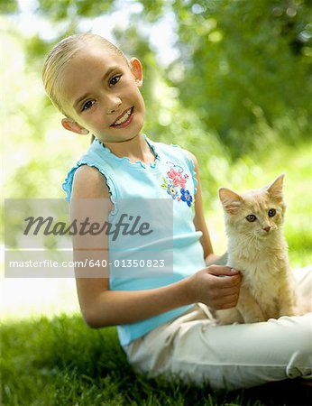 Portrait of a girl sitting with a kitten Stock Photo - Premium Royalty-Free, Image code: 640-01350823