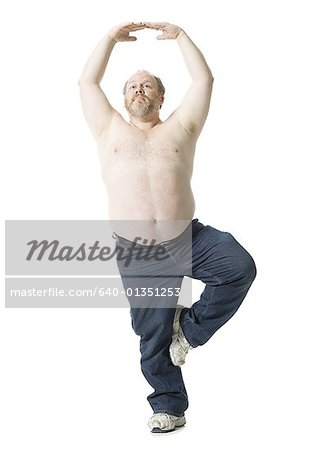Close-up of a mature man standing on one leg Stock Photo - Premium Royalty-Free, Image code: 640-01351253