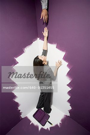 High angle view of a mid adult woman reaching out for a man's hand Stock Photo - Premium Royalty-Free, Image code: 640-01351455