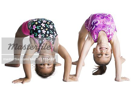 Young female gymnasts bending backwards Stock Photo - Premium Royalty-Free, Image code: 640-01351488