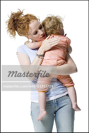 Close-up of a young woman hugging her daughter Stock Photo - Premium Royalty-Free, Image code: 640-01351729