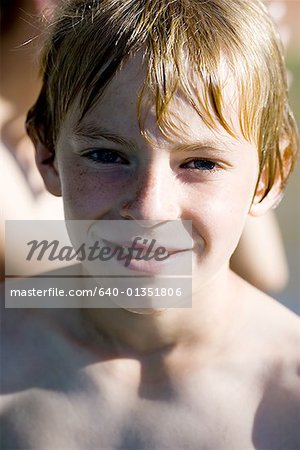 Portrait of a boy smiling Stock Photo - Premium Royalty-Free, Image code: 640-01351806