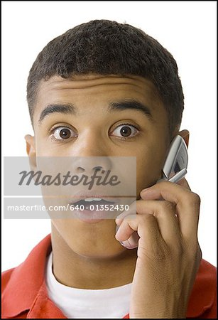 Portrait of a young man talking on a mobile phone Stock Photo - Premium Royalty-Free, Image code: 640-01352430