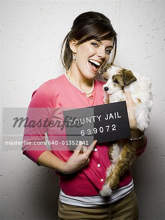 Mug shot of woman with dog Stock Photo - Premium Royalty-Free, Image code: 640-01352841