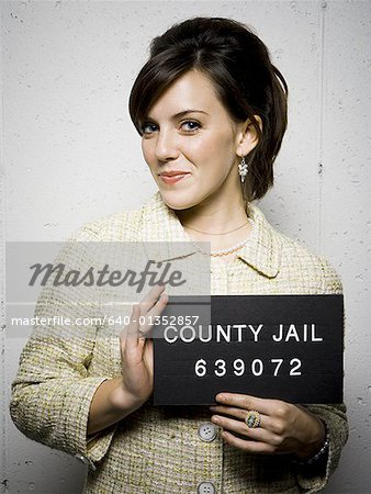 Mug shot of formally dressed woman Stock Photo - Premium Royalty-Free, Image code: 640-01352857