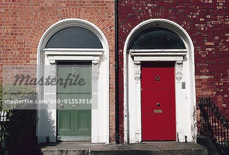Two colored doors on the front of a building Stock Photo - Premium Royalty-Free, Image code: 640-01353018