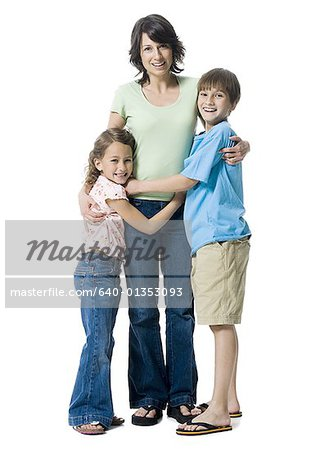 Portrait of a boy and a girl hugging their mother Stock Photo - Premium Royalty-Free, Image code: 640-01353093