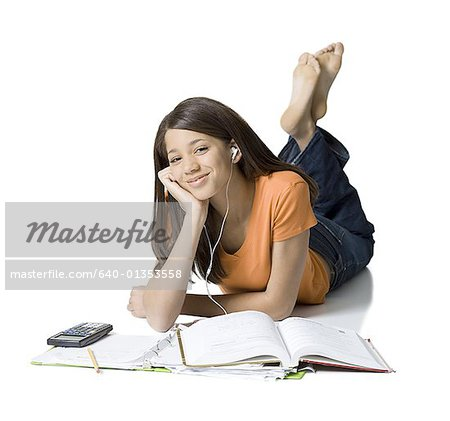 Portrait of a girl listening to music and studying Stock Photo - Premium Royalty-Free, Image code: 640-01353558