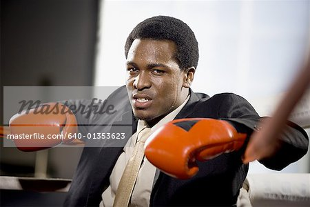 Portrait of a young man sitting in a boxing ring Stock Photo - Premium Royalty-Free, Image code: 640-01353623