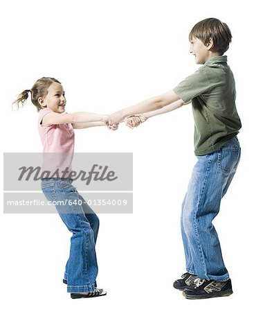 Close-up of a boy playing with his sister Stock Photo - Premium Royalty-Free, Image code: 640-01354009