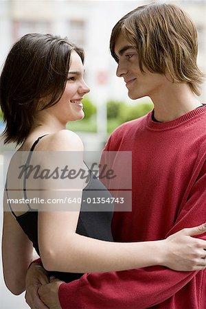 Profile of a young couple embracing Stock Photo - Premium Royalty-Free, Image code: 640-01354743