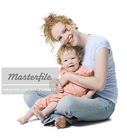 Portrait of a young woman sitting with her daughter Stock Photo - Premium Royalty-Free, Image code: 640-01354837