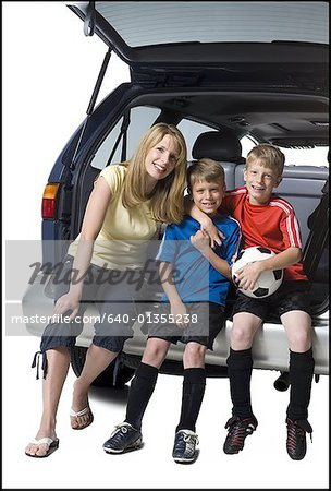 Soccer mom with sons Stock Photo - Premium Royalty-Free, Image code: 640-01355238