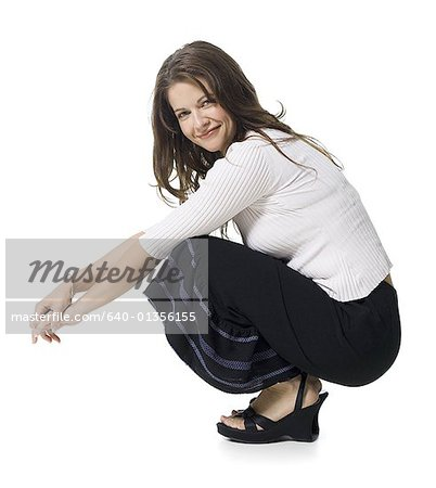 Portrait of a mid adult woman smiling Stock Photo - Premium Royalty-Free, Image code: 640-01356155