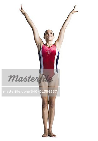 Female gymnast doing floor exercises Stock Photo - Premium Royalty-Free, Image code: 640-01356237