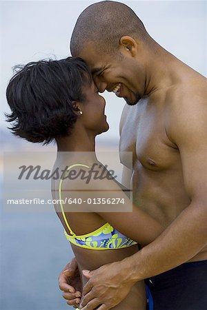 Profile of a young couple hugging each other Stock Photo - Premium Royalty-Free, Image code: 640-01356274