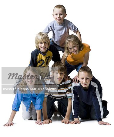 Portrait of a group of children making a human pyramid Stock Photo - Premium Royalty-Free, Image code: 640-01356496