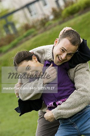 Portrait of a father with his daughter in a park Stock Photo - Premium Royalty-Free, Image code: 640-01357027
