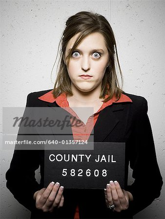 Mug shot of woman in business attire Stock Photo - Premium Royalty-Free, Image code: 640-01357124