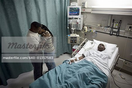 High angle view of parents in a hospital with their son Stock Photo - Premium Royalty-Free, Image code: 640-01357583