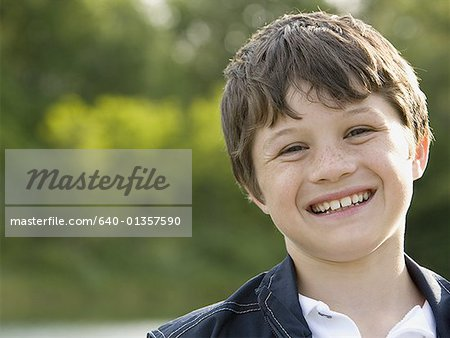 Portrait of a boy smiling Stock Photo - Premium Royalty-Free, Image code: 640-01357590