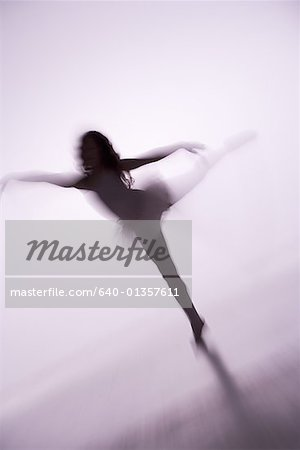 Blurred view of a girl doing ballet Stock Photo - Premium Royalty-Free, Image code: 640-01357611