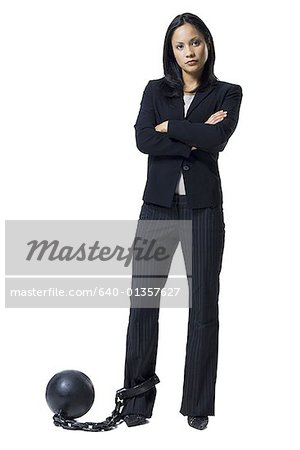 Businesswoman shackled to ball and chain Stock Photo - Premium Royalty-Free, Image code: 640-01357627