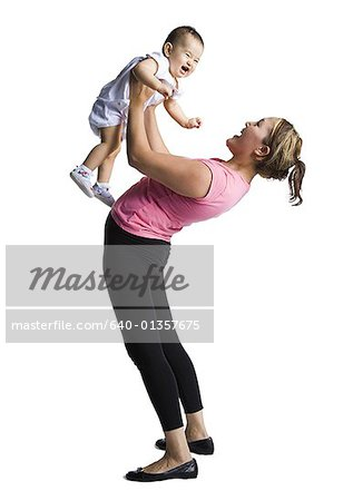 Contortionist mother with baby daughter Stock Photo - Premium Royalty-Free, Image code: 640-01357675