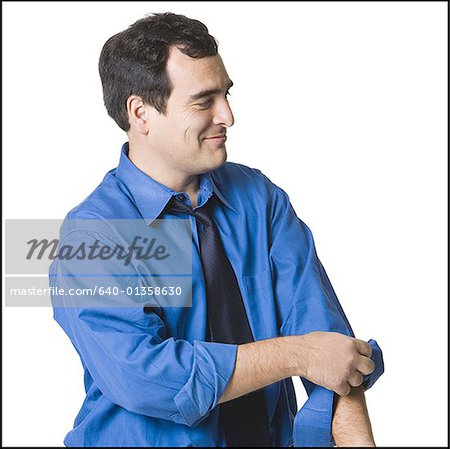 Businessman rolling up his sleeves