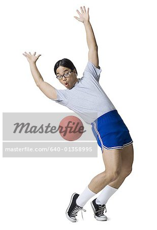 Young man playing with a basketball Stock Photo - Premium Royalty-Free, Image code: 640-01358995