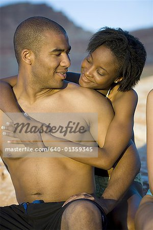 Young couple hugging outdoors Stock Photo - Premium Royalty-Free, Image code: 640-01359345