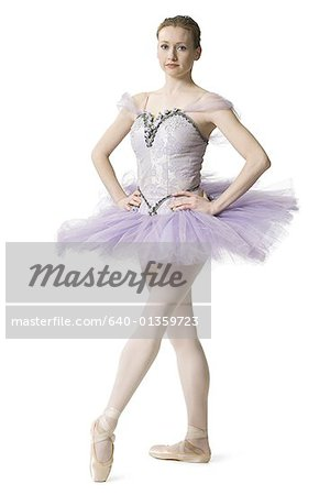 Ballerina standing with arms akimbo Stock Photo - Premium Royalty-Free, Image code: 640-01359723