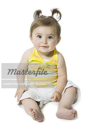 Portrait of a baby girl smiling Stock Photo - Premium Royalty-Free, Image code: 640-01359777