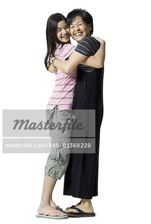Portrait of a mother and her daughter hugging Stock Photo - Premium Royalty-Free, Image code: 640-01360220
