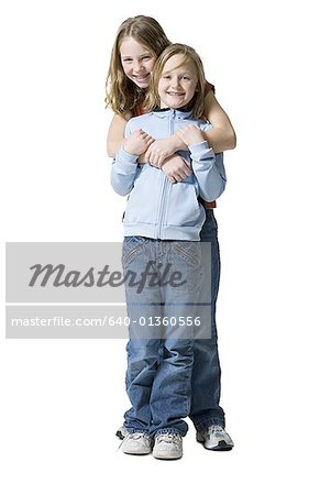 Portrait of two sisters smiling Stock Photo - Premium Royalty-Free, Image code: 640-01360556