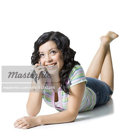 Close-up of a teenage girl talking on a mobile phone Stock Photo - Premium Royalty-Free, Image code: 640-01361245