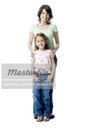 Portrait of a girl standing with her mother Stock Photo - Premium Royalty-Free, Image code: 640-01361473