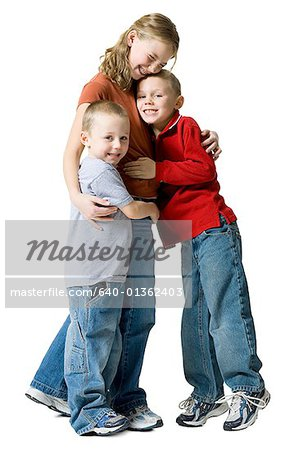 Portrait of two brothers hugging their sister Stock Photo - Premium Royalty-Free, Image code: 640-01362403