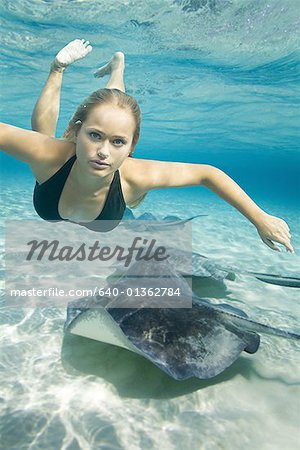 Portrait of a teenage girl swimming underwater Stock Photo - Premium Royalty-Free, Image code: 640-01362784