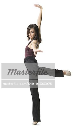 Portrait of a young woman dancing Stock Photo - Premium Royalty-Free, Image code: 640-01363075