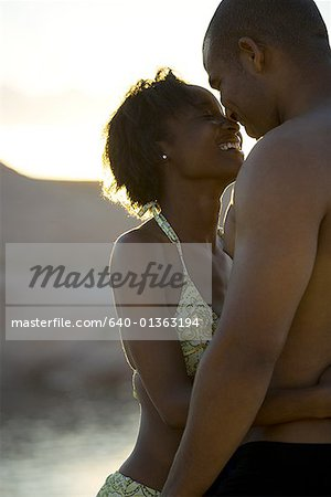 Profile of a young couple hugging Stock Photo - Premium Royalty-Free, Image code: 640-01363194