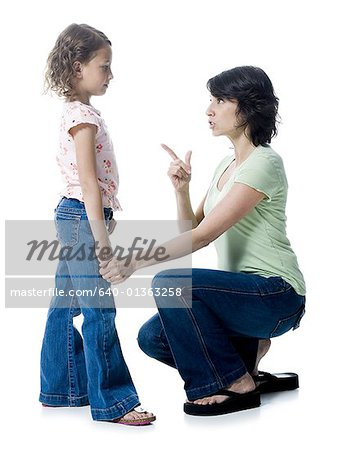 Close-up of a mid adult woman scolding her daughter Stock Photo - Premium Royalty-Free, Image code: 640-01363258