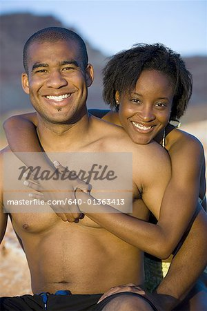 Portrait of a young couple hugging Stock Photo - Premium Royalty-Free, Image code: 640-01363413