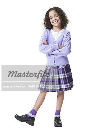 Portrait of a girl standing with her arms crossed Stock Photo - Premium Royalty-Free, Image code: 640-01363532