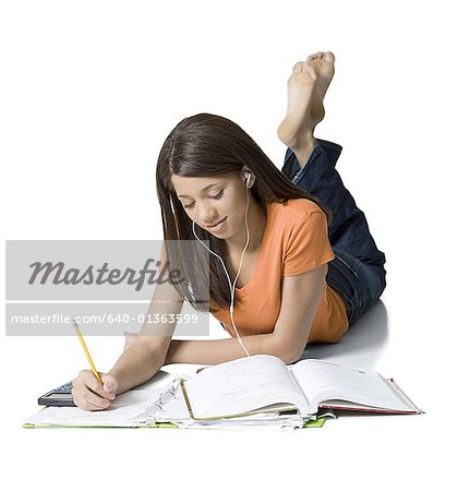 Close-up of a girl writing in a notebook Stock Photo - Premium Royalty-Free, Image code: 640-01363599