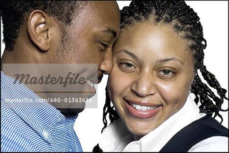 Close-up of a young couple hugging each other Stock Photo - Premium Royalty-Free, Image code: 640-01363610