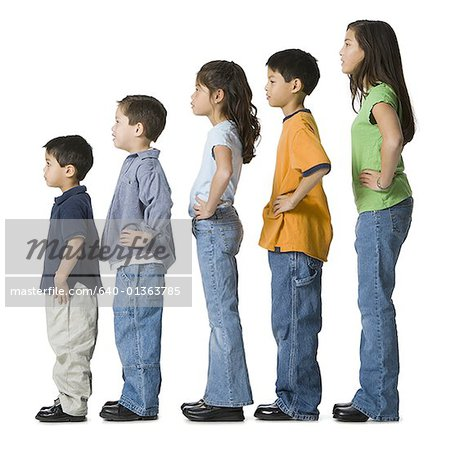 Profile of a children in profile with their hands on their hips Stock Photo - Premium Royalty-Free, Image code: 640-01363785