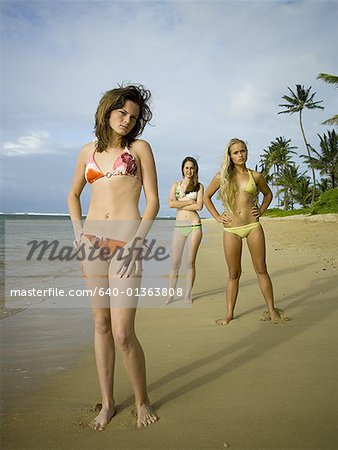 Portrait of three teenage girls standing on the beach Stock Photo - Premium Royalty-Free, Image code: 640-01363808