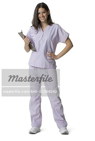 Portrait of a female nurse holding a clipboard Stock Photo - Premium Royalty-Free, Image code: 640-01364042